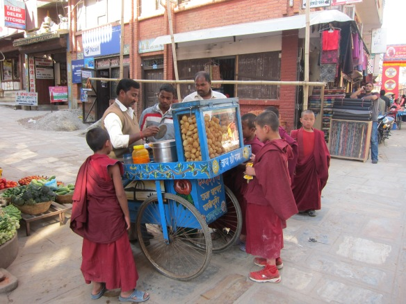 Young monks getting provisions before a teaching. Boudhanath, Nepal
